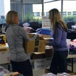 Photo of volunteers assisting with Granite Education Foundation's Santa Sacks