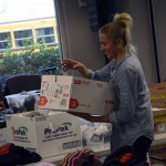 Photo of volunteer assisting with Granite Education Foundation's Santa Sacks