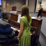 Photo of Cyprus High student performing during board meeting
