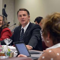 Photo of superintendent addressing departing board member