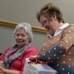 Photo of departing board member opening gift