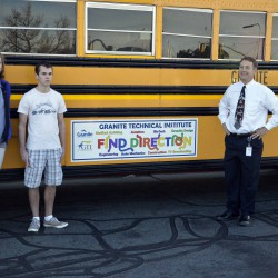 Photo of Bus Ad Contest winners with superitendent