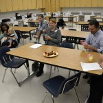 Photo of parents eating food prepared at Wasatch Jr High