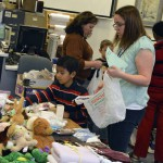 Photo of students picking items from Roosevelt Holiday Store