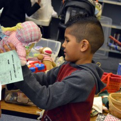 Photo of student picking items from Roosevelt Holiday Store