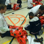 Photo of Vivint employees giving gifts to Lincoln Elementary students