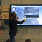 Photo of students demonstrating school's weather station