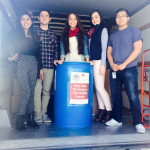 Photo of Granger High students with donated food bin