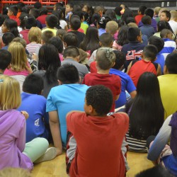 Photo of students sitting during an assembly