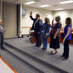 Photo of board members being sworn in to office