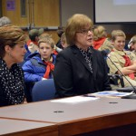 Photo of two administrators presenting to board of education