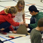 Photo of Western Hills student building structures on Engineering Day