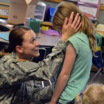 Photo of parent surprising children at West Kearns Elementary