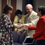 Photo of teacher receiving gifts for National Board Certification