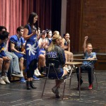 Photo of sixth-grader playing game with Taylorsville High cheerleader