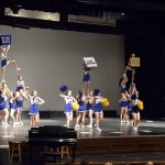 Photo of Taylorsville cheerleaders performing for elementary students