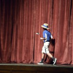 Photo of Taylorsville High golfer walking on stage