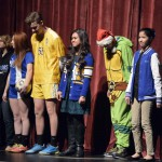 Photo of Taylorsville High athletes standing on stage
