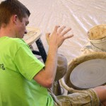 Photo of student creating ceramics during Art Night Live