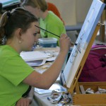 Photo of student painting during Art Night Live