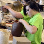 Photo of student sculpting during Art Night Live