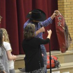 Photo of Deanie Wimmer addressing Farnsworth Elementary students