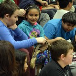 Photo of Farnsworth students examining rodeo gear
