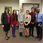 Photo of West Lake students and principal during board meeting