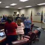 Photo of board members reciting pledge of allegiance