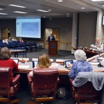 Photo of administrator addressing board of education