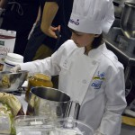 Photo of Future Chefs contestant mixing ingredients