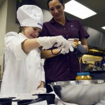 Photo of Future Chefs contestant pouring ingredients