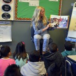 Photo of teacher reading new book to Wilson Elementary students