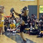 Photo of Kearns High mascots performing for students