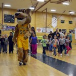 Photo of Kearns High mascot leading kindergarten students