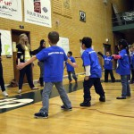 Photo of Kearns Network kindergarteners playing games with Kearns High students