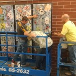 Photo of Granger High mural being installed