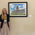 Photo of Alyssa Bowman with artwork