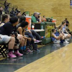 Photo of girls all stars sitting on bench during All Star Game
