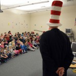 Photo of superintendent reading book to Wright Elementary students