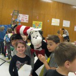 Photo of students with book character mascot