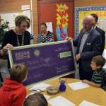 Photo of Beehive Elementary teacher being announced as Excel Award recipient