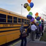 Photo of Granite Education Foundation committee members boarding school bus