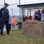 Photo of Hunter High softball coach viewing name plaque