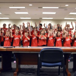 Photo of Neil Armstrong Academy choir singing at board meeting