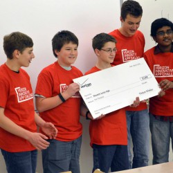 Photo of Wasatch Jr High students receiving large check