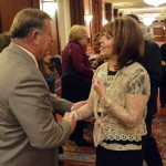 Photo of employee shaking hands with board member at 25 Year Celebration