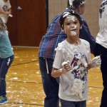 Photo of Whittier student covered in shaving cream