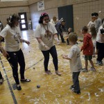 Photo of Whittier volunteers and students participating in sensory activity