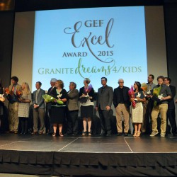 Photo of Excel Award recipients on stage